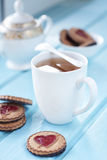 Morning tea cup with cookies Stock Image