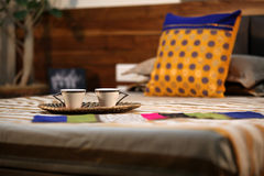 Morning Tea. Fresh tea served in a Cane tray on the bed in the morning Stock Images