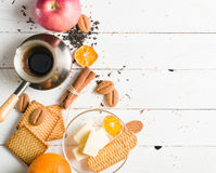 Morning tea with fruit and candied fruit. White wooden background. Morning tea with fruit and candied fruit. White wooden background and place for text royalty free stock photo