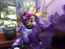 Morning Tea and Garden Flowers Stock Photos