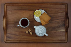 Morning tea with lemon. Tea set on a tray with lemon and biscuits Stock Photos