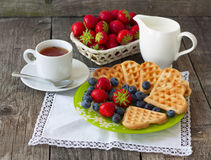 Morning tea with waffles, milk and fresh berries Stock Photography