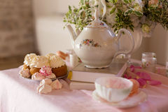 Morning tearoom table setting. With flower composition and cakes Stock Photos