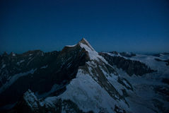 Morning time in Alps. Sunrise in Matterhorn region above Breuil Cervinia Royalty Free Stock Photos