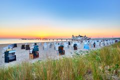 Morning time at baltic sea beach and sight Ahlbeck pier in sunrise. Morning time at baltic sea beach in Ahlbeck pier in sunrise stock photography