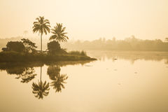 Morning time on a lakeside with clouds and reflected. In Thailand Royalty Free Stock Photo
