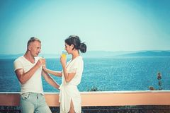 Morning time of woman and man at sea resort. Couple in love relax on balcony. Family and valentines day. Summer. Morning time of women and men at sea resort stock image