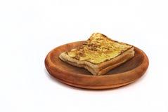 Morning toast. On wooden plate Stock Photos