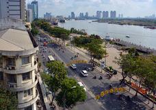 Morning on Ton Duc Thang Street beside the Saigon River. Ho Chi Minh City, Vietnam - April 07, 2015: Panoramic aerial view of the Saigon River, port, Ton Duc Royalty Free Stock Image