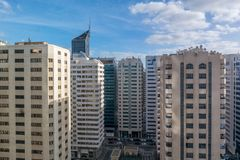 Morning top view of city skyscrapers and buildings against blue cloudy sky.  royalty free stock photos