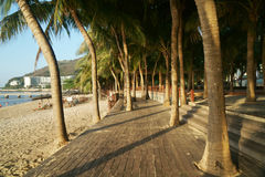 Morning tourist embankment with palm trees along beach at Dadonghai Bay on Hainan Island, China Stock Photos