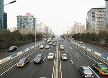 City traffic on modern street in Beijing China. Morning traffic in business district of chinese capital Beijing. Cars are rushing royalty free stock images