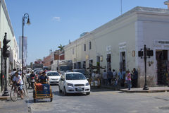 Morning traffic in colonial town in Mexico. VALLADOLID, YUCATAN, MEXICO - FEBRUARY 24, 2017: The hustle and bustle of morning traffic at a busy intersection is Royalty Free Stock Photography
