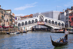 Morning traffic on Grand Canal under Rialto bridge Stock Images