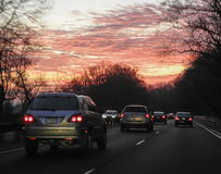 Morning Traffic. The morning rush heads into a glowing morning sunrise Stock Image