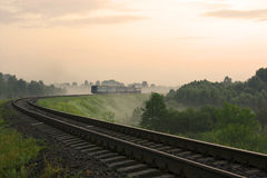 Morning Train. Passing in the fog Royalty Free Stock Images