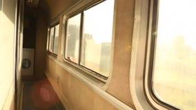 Morning Train Ride. With Sun shining through stock footage