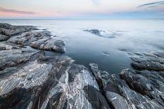 Morning tranquil minimalist landscape of stony coast. Royalty Free Stock Image