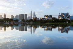Morning tranquility in Kuala Lumpur, Malaysia. View of reflection lake in Kuala Lumpur cityscape Stock Photos