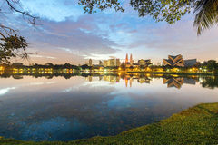 Morning tranquility in Kuala Lumpur, Malaysia. View of reflection lake in Kuala Lumpur cityscape Royalty Free Stock Photos