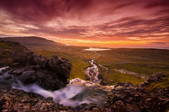 Morning Tranquility. View over the mountains at a waterfall on  Iceland Royalty Free Stock Photography