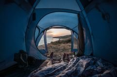 Morning traveling couple in a tent by the sea, first-person view stock image