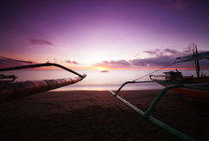 Morning Treader. Boats on the beach waiting for the break of day Royalty Free Stock Image