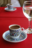 Morning in Turkey. Black turkish cofee and glass water on a red cloth Stock Images