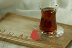 Morning turkish tea in traditional glass with red paper heart, b Stock Photo