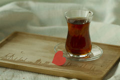 Morning turkish tea in traditional glass with red paper heart, b Royalty Free Stock Photo