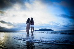 Two girls in the beach royalty free stock photography