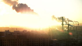 Morning in urban city. St. Petersburg. From pipe goes smoke. construction site cranes are working. Russia. Morning in a large urban city. St. Petersburg. From stock video footage