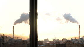 Morning in urban city. St. Petersburg. From pipe goes smoke. construction site cranes are working. Russia stock video