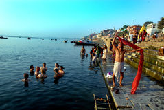Morning at Varanasi. March 29,2013 Varanasi,Benaras,Uttar Pradesh,India,Asia-Pilgrims bathing in the River Ganges at Varanasi, India Royalty Free Stock Photography