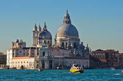 Morning in Venice, boats, Grand Canal and Santa Maria church Royalty Free Stock Images