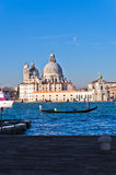 Morning in Venice, gondolas, Grand Canal and Santa Maria church Royalty Free Stock Photography