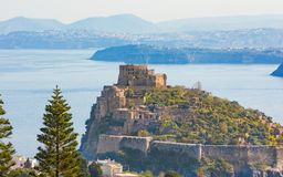 Aragonese Castle or Castello Aragonese near Ischia island, Italy. Morning view of Aragonese Castle or Castello Aragonese - famous landmark and tourist Royalty Free Stock Image