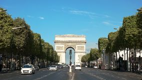 Morning view of the arc de triomphe and the avenue champs de elysees. A morning view of the arc de triomphe de l`etoile, on the avenue champs de elysees stock images
