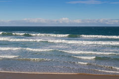 Morning view of the beach with breaking waves crashing sand on s Stock Photo