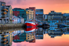 Morning view on buildings and boats in docks Royalty Free Stock Photo