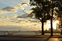 Morning view of Cleveland skyline, Lake Erie, and paraglider. From Edgewater park stock image