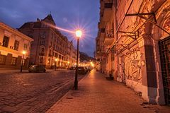 A morning view of colourful buildings on empty Andriyivskyy Uzvoz Descent. One of the oldest street in Kyiv. This street connecting Upper Town district and the Royalty Free Stock Photo