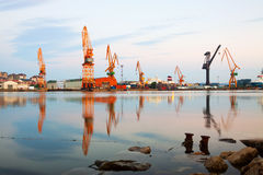 Morning view of   cranes  in  seaport Royalty Free Stock Photo
