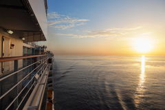 Morning view from deck of cruise ship. Beautiful sunset above water Royalty Free Stock Photography