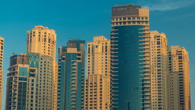 Morning view of Dubai Marina Towers in Dubai timelapse. Morning vew of Dubai Marina modern Towers from yacht club in Dubai timelapse at sunrise time, United Arab stock footage