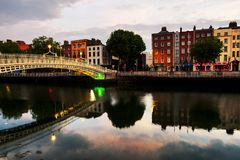 Morning view of famous illuminated Ha Penny Bridge in Dublin, Ireland. Dublin, Ireland. Morning view of famous illuminated Ha Penny Bridge in Dublin, Ireland stock images