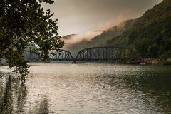 Morning View of New River Railroad Bridge - West Virginia. A morning view of a landmark and historic bridge, built by the Chesapeake and Ohio Railroad and now royalty free stock photo