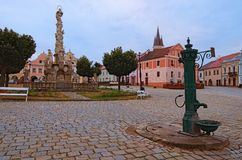Morning view of main square in Telc with Plague Column, ancient water pump and colorful buildings. A UNESCO World Heritage Site. Southern Moravia, Czech royalty free stock images