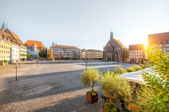 Central square of the old town in Nurnberg, Germany. Morning view on the market square with church of Our Lady in Nurnberg, Germany stock images