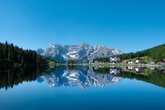 Morning view of Misurina lake with water reflection of Morning view of Misurina lake with water reflection of the Tre Cime di Lave royalty free stock image
